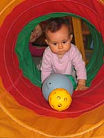 baby playing in the tunnel at Gymboree in Mill Valley