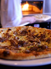 Duck confit pizza from Brick and Bottle