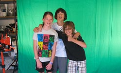 Kids in front of green screen at digital filmmaking class