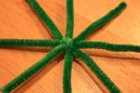 Pipe cleaners folded for star ornament