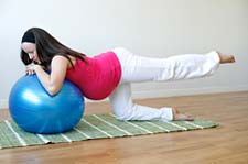 Pilates pregnant woman with exercise ball