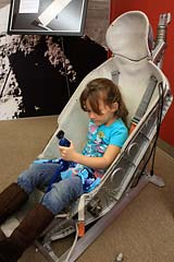 Trying out the Soyuz spacecraft seat at Space Station in Novato