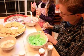 Decorating sugar cookies for Christmas