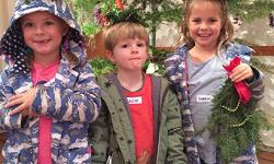 Children Holding Holiday Nature Crafts