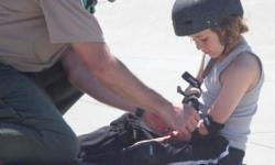 Ranger helping a skater
