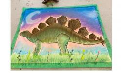 creative drawing in pastel of a dinosaur