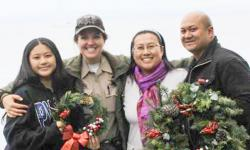 family with wreaths
