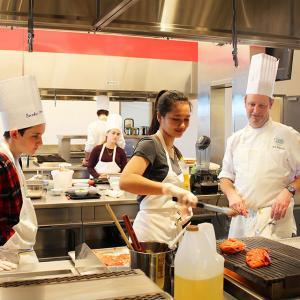 teenagers cooking in the Hestan Kitchen