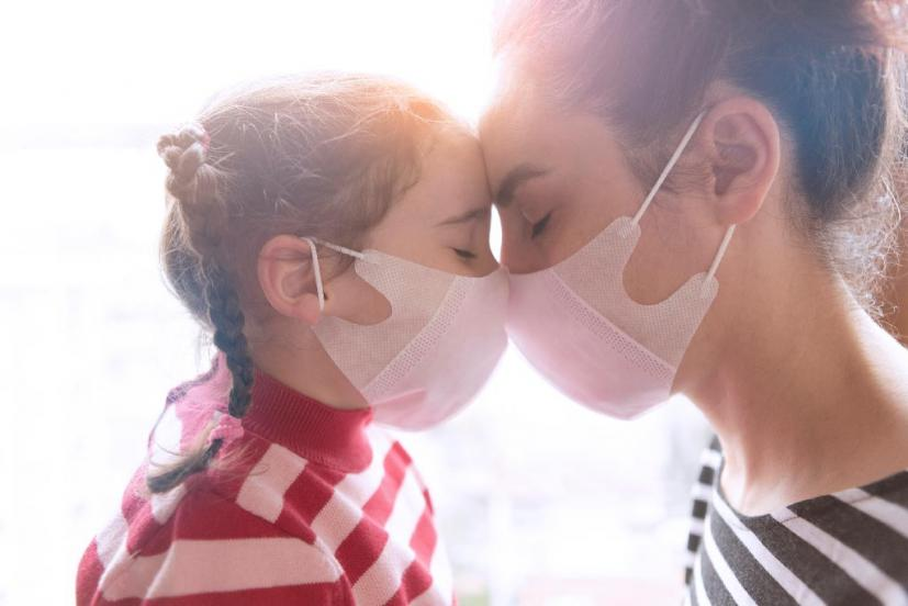 Mother and daughter wearing masks