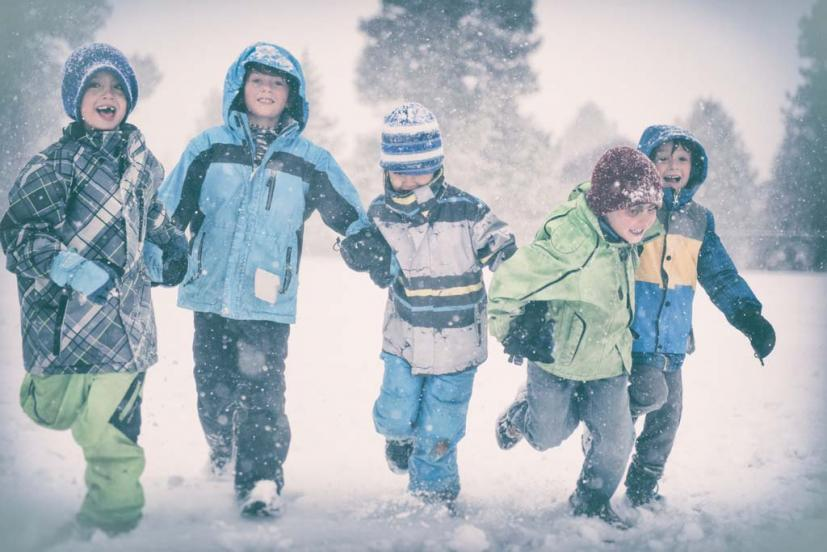 kids running in snow